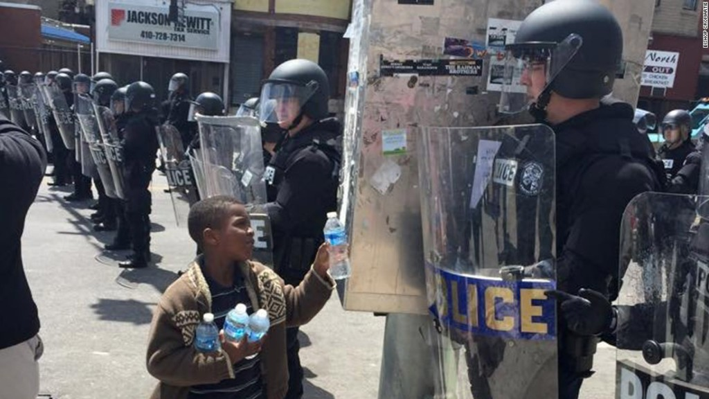 150428181210-baltimore-boy-offers-officer-water-super-169